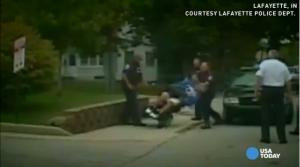 cop_beats_handicap_man